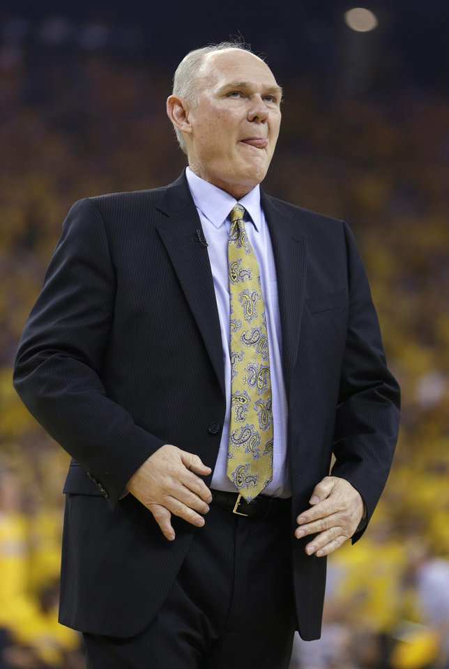 Photo - Denver Nuggets coach George Karl watches his team play the Golden State Warriors during the first half of Game 6 in a first-round NBA basketball playoff series in Oakland, Calif., Thursday, May 2, 2013. (AP Photo/Ben Margot)