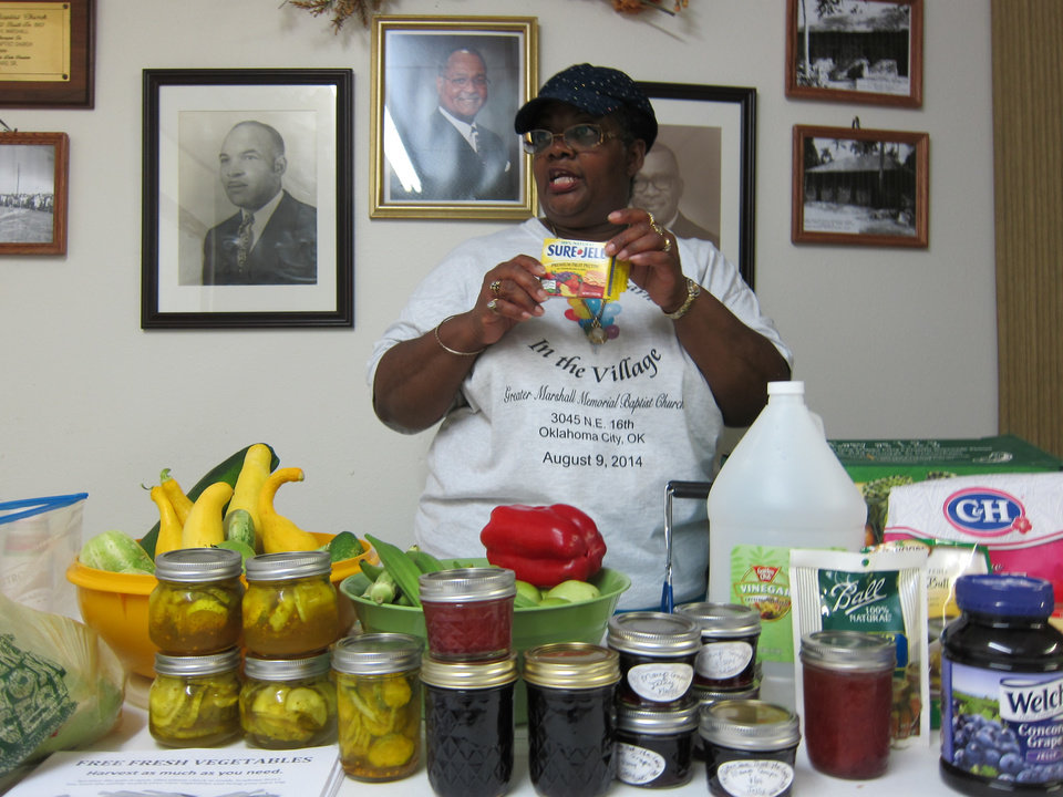 "Photo -  Mary Howard conducts a demonstration about canning and jam and jelly preparation during the ""Lunch and Learn in the Village"" community outreach at Greater Marshall Memorial Baptist Church, 3045 NE 16. Photo by Carla Hinton, The Oklahoman"