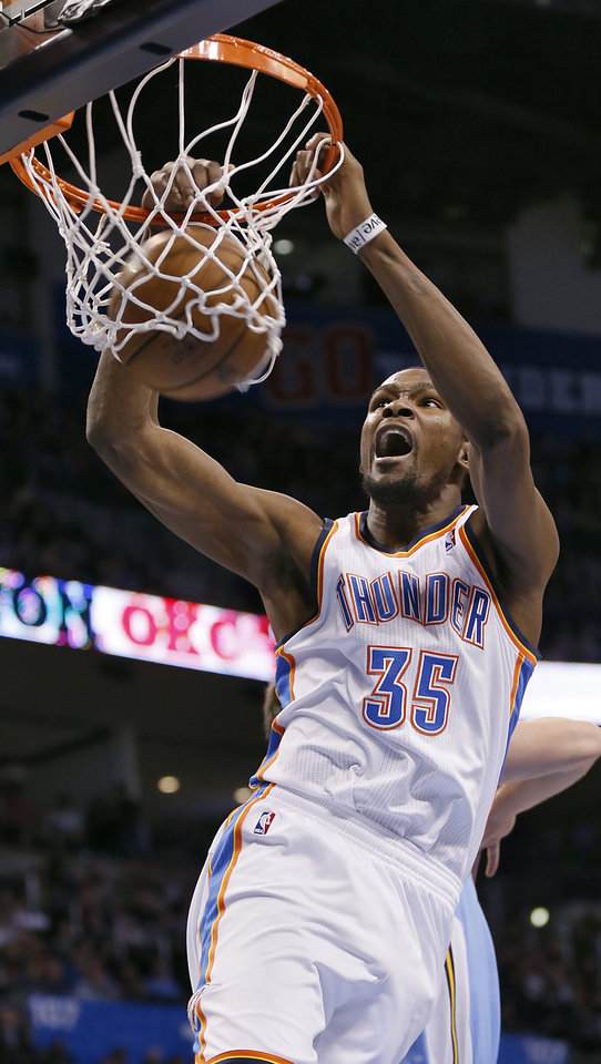 Photo - Oklahoma City's Kevin Durant (35) dunks the ball during the NBA basketball game between the Oklahoma City Thunder and the Denver Nuggets at the Chesapeake Energy Arena on Wednesday, Jan. 16, 2013, in Oklahoma City, Okla.  Photo by Chris Landsberger, The Oklahoman