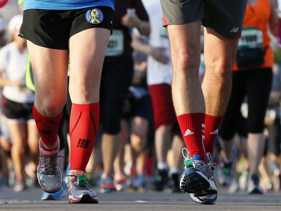 Runners wear red socks in support of the victims of the Boston Marathon bombing, during the Oklahoma City Memorial Marathon in Oklahoma City, Sunday, April 28, 2013. Photo by Nate Billings, The Oklahoman