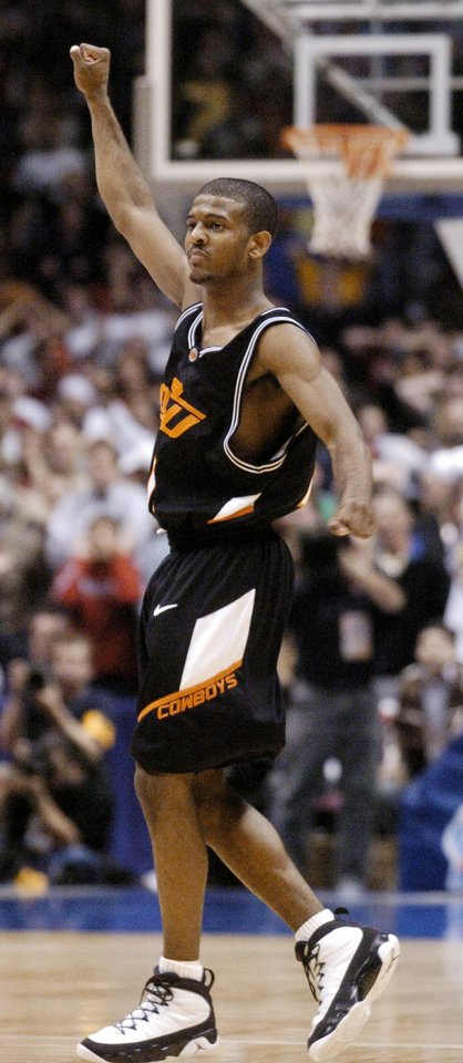 Photo - East Rutherford March 27, 2004. East Rutherford Regional, NCAA men's college basketball tournament at Continental Airlines Arena. Oklahoma State University (OSU) and Saint Joseph's.  John Lucas celebrates after making the winning shot. Staff photo by Bryan Terry.