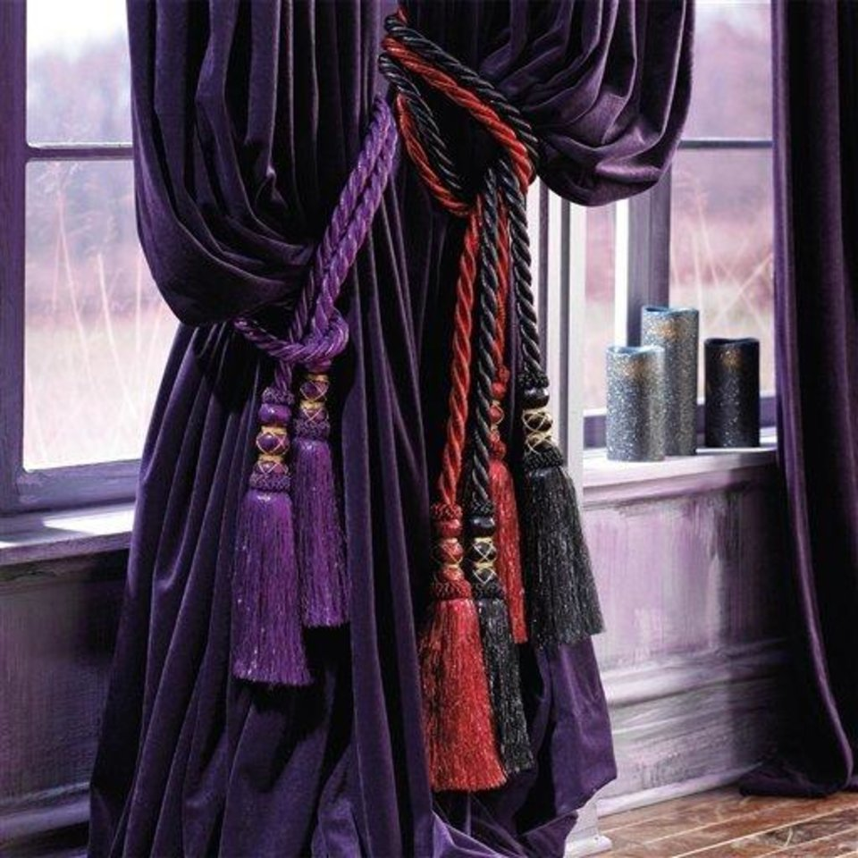 Photo - This product image released by Grandin Road shows their Theater Cords. These thick velvety tasseled cords evoke the Opera. This season you'll find lots of ghoulish yet glamorous pieces to decorate with for Halloween.   (AP Photo/Grandin Road)