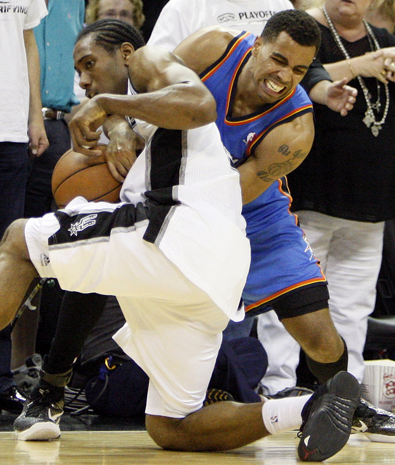 San Antonio's Kawhi Leonard (2) pressures Oklahoma City's Thabo Sefolosha (2) before the ball goes out of bounds off of the Thunder late in the fourth quarter, giving San Antonio a chance to tie the game, during Game 5 of the Western Conference Finals between the Oklahoma City Thunder and the San Antonio Spurs in the NBA basketball playoffs at the AT&T Center in San Antonio, Monday, June 4, 2012. The Thunder won, 108-103. Photo by Nate Billings, The Oklahoman