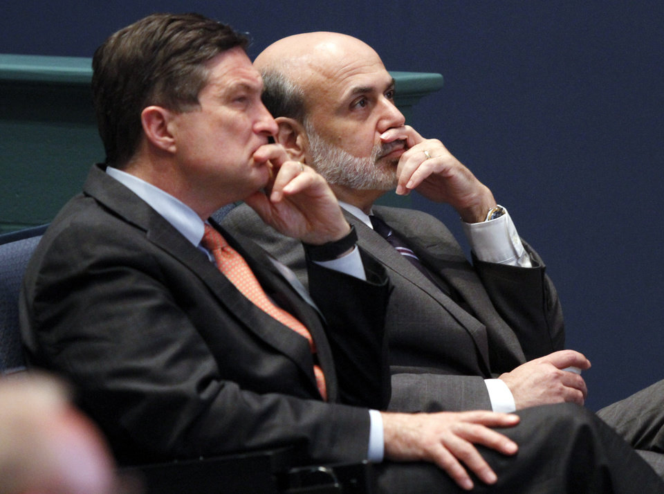 """Photo - FILE - In this June 9, 2010, file photo, Federal Reserve Chairman, Ben Bernanke, right, listens with president of the Federal Reserve of Richmond, Jeffrey Lacker, left, at J. Sergeant Reynolds Community College in Richmond, Va.  With an eye on the """"fiscal cliff,"""" the Federal Reserve is expected to announce a new bond-buying plan to support the U.S. economy on Tuesday, Dec. 11, 2012. Lacker has said he thinks the job market is being slowed by factors beyond the Fed's control and he says further bond purchases risk worsening future inflation. (AP Photo/Steve Helber, File)"""