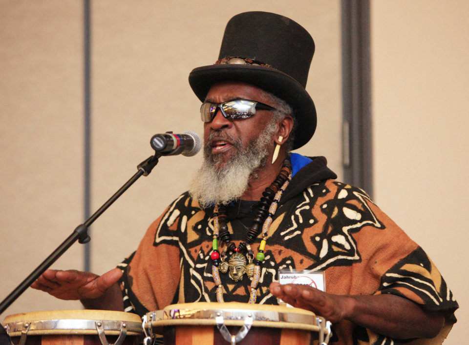 Photo - Jahruba, master drummer and storyteller from Norman, performs Monday during the 17th annual Midwest City Dr. Martin Luther King Jr. Prayer Breakfast in Midwest City.    PAUL B. SOUTHERLAND - PAUL B. SOUTHERLAND
