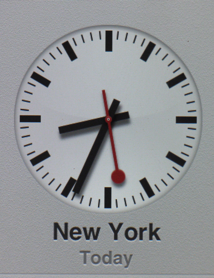 Photo -   A clock symbol is displayed on an iPad with the new iOS 6 Friday, Sept.21, 2012 in Nauen, eastern Germany. Switzerland's national rail company is accusing Apple Inc. of stealing the iconic look of its station clocks for the iOS 6 operating system used by iPhone and iPad mobile devices. Both designs have a round clock face with black indicators except for the second hand which is red. (AP Photo/Ferdinand Ostrop)