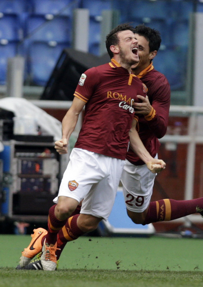 Photo - AS Roma midfielder Alessandro Florenzi celebrates after he scored during a Serie A soccer match between AS Roma and Genoa, at Rome's Olympic Stadium, Sunday, Jan. 12, 2014. (AP Photo/Andrew Medichini)
