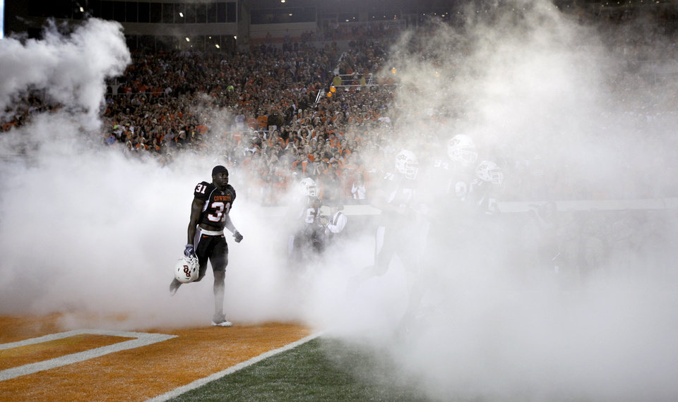 Photo - The Cowboys take the field before the college football game between Oklahoma State University (OSU) and the University of Colorado (CU) at Boone Pickens Stadium in Stillwater, Okla., Thursday, Nov. 19, 2009. Photo by Sarah Phipps, The Oklahoman