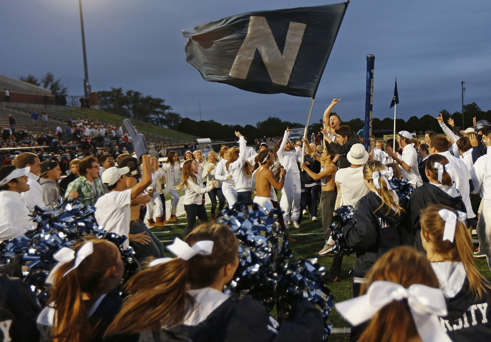Photo - Edmond North students gather before the start of a high school football game against Yukon at Wantland Stadium in Edmond, Okla., Thursday, October 4, 2012. Photo by Bryan Terry, The Oklahoman