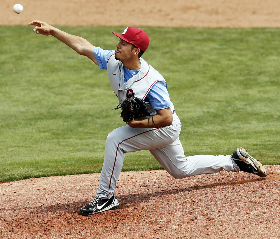 OU's Ralph Garza Jr. pitches in the 8th inning during an NCAA baseball game between Oklahoma and Texas Tech in the Big 12 Baseball Championship tournament at the Chickasaw Bricktown Ballpark in Oklahoma City, Friday, May 24, 2013. OU won 8-0. Photo by Nate Billings, The Oklahoman