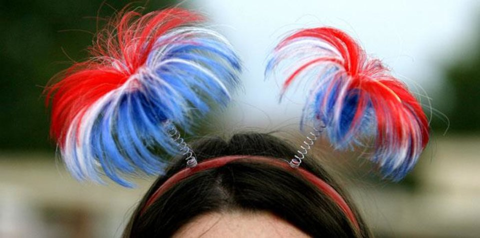 Photo -  UNIVERSITY OF CENTRAL OKLAHOMA, FOURTH OF JULY, 4TH OF JULY, INDEPENDENCE DAY, ACTIVITIES, FESTIVITIES, LIBERTYFEST: Kristen Gregory sported a festive Fourth of July headband during Liberty Fest at UCO campus in Edmond, Okla. Saturday, July 4, 2009.  Photo by Ashley McKee, The Oklahoman   ORG XMIT: KOD