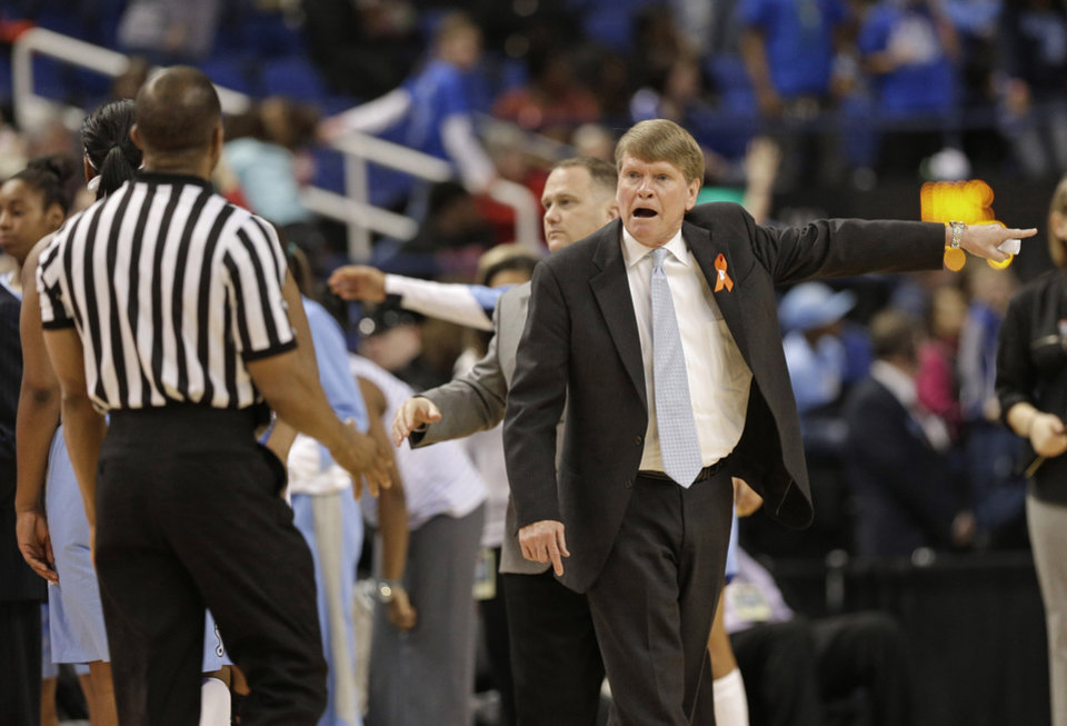 North Carolina associate head coach Andrew Calder, right, argues a call during the second half of an NCAA college basketball game against Maryland at the Atlantic Coast Conference tournament in Greensboro, N.C., Friday, March 7, 2014. North Carolina won 73-70. (AP Photo/Chuck Burton)