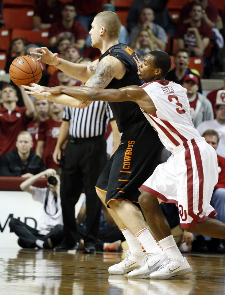 Photo - Sooner's Buddy Hield (3) tries to defend Cowboy's Philip Jurick (44) during the second half as the University of Oklahoma Sooners (OU) defeat  the Oklahoma State Cowboys (OSU) 77-68  in NCAA, men's college basketball at The Lloyd Noble Center on Saturday, Jan. 12, 2013  in Norman, Okla. Photo by Steve Sisney, The Oklahoman