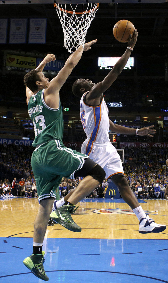 Photo - Oklahoma City's Reggie Jackson (15) attempts a lay up over Boston's Kris Humphries (43) during the NBA game between the Oklahoma City Thunder and the Boston Celtics at the Chesapeake Energy Arena., Sunday, Jan. 5, 2014. Photo by Sarah Phipps, The Oklahoman