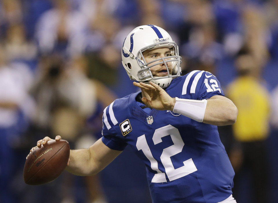 Photo - Indianapolis Colts quarterback Andrew Luck (12) throws during the first half of an NFL wild-card playoff football game against the Kansas City Chiefs Saturday, Jan. 4, 2014, in Indianapolis. (AP Photo/Michael Conroy)