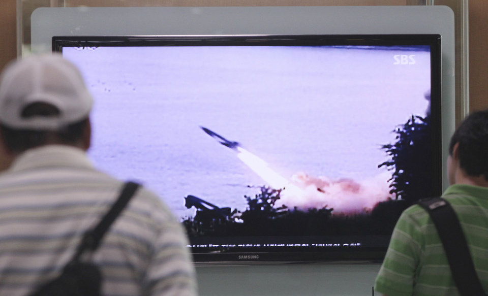 Photo - People watch a TV news program showing the missile launch conducted by North Korea, at Seoul Railway Station in Seoul, South Korea, Sunday, June 29, 2014. North Korea fired two short-range missiles into its eastern waters Sunday, a South Korean official said, an apparent test fire that comes just days after the country tested what it called new precision-guided missiles. (AP Photo/Ahn Young-joon)