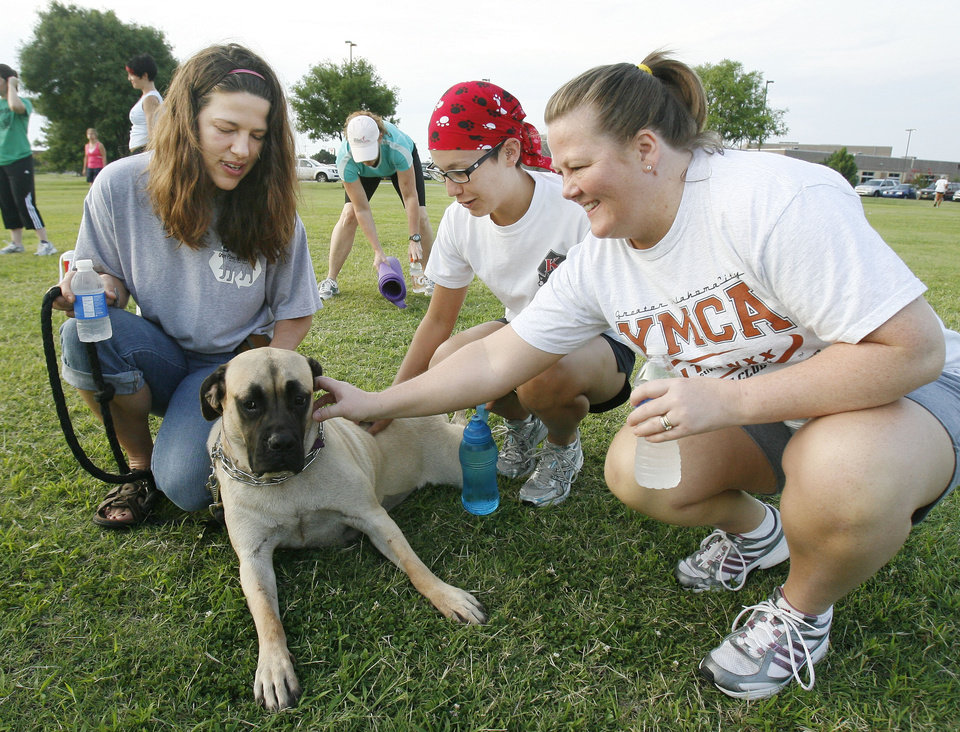 Photo - DONATE / DONATION: Mastiff foster mom Julie Moseley (left) shows mastiff