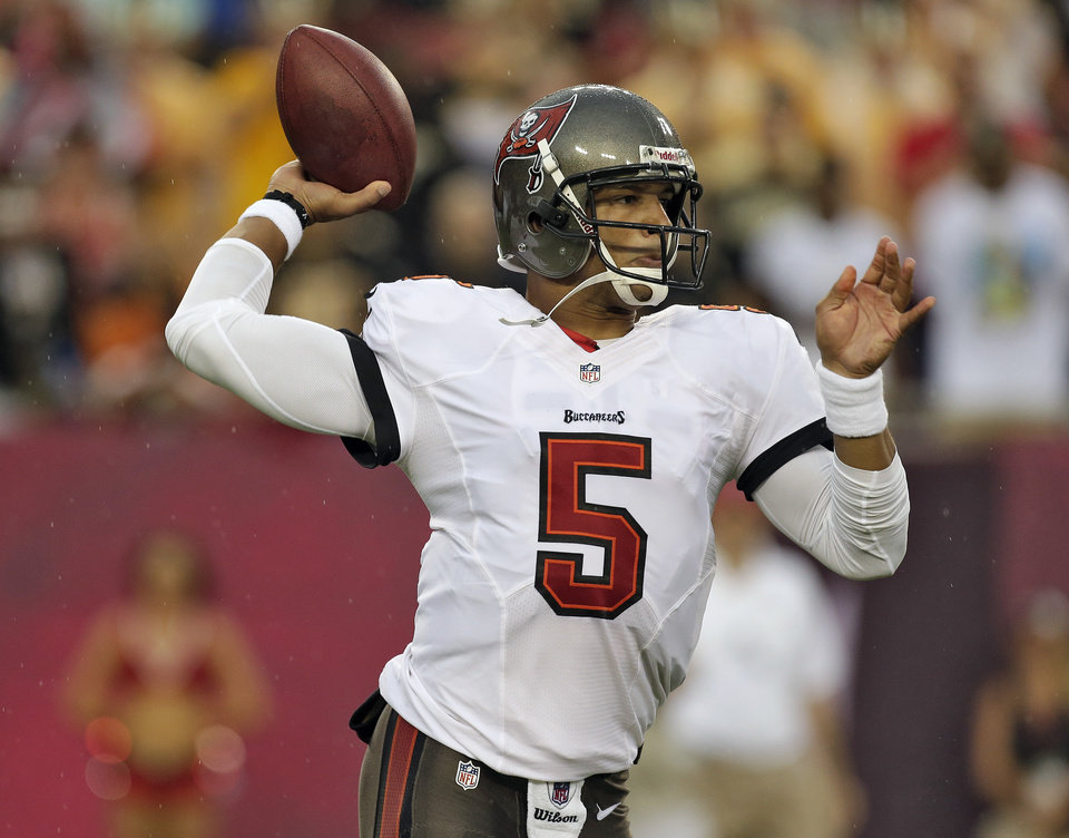 Photo - FILe - In this Sept. 15, 2013 file photo, Tampa Bay Buccaneers quarterback Josh Freeman (5) throws a pass against the New Orleans Saints during the first quarter of an NFL football game  in Tampa, Fla.  The Buccaneers have released Freeman, Thursday, Oct. 3. 2013, one week after benching the fifth-year pro in favor of rookie Mike Glennon.  (AP Photo/Chris O'Meara, File)