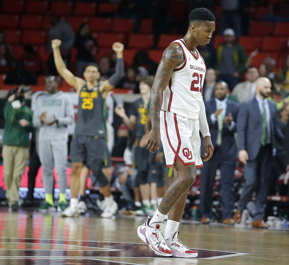 Photo - Oklahoma's Kristian Doolittle (21) walks off the court after a men's NCAA basketball game between the University of Oklahoma Sooners (OU) and the Baylor Bears at the Lloyd Noble Center in Norman, Okla., Tuesday, Feb. 18, 2020. Baylor won 65-54. [Bryan Terry/The Oklahoman]