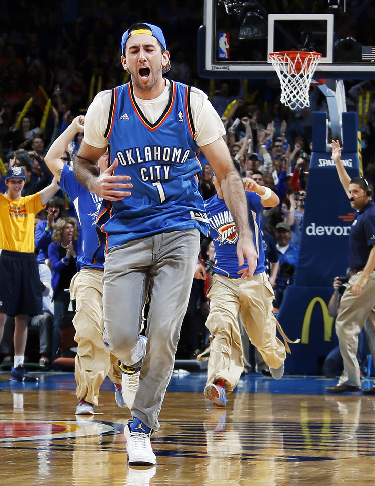 Photo - Cameron Rodriguez reacts after hitting the MidFirst Bank $20,000 half-court shot during an NBA basketball game between the Oklahoma City Thunder and the Denver Nuggets at Chesapeake Energy Arena in Oklahoma City, Monday, Nov. 18, 2013. Photo by Nate Billings, The Oklahoman