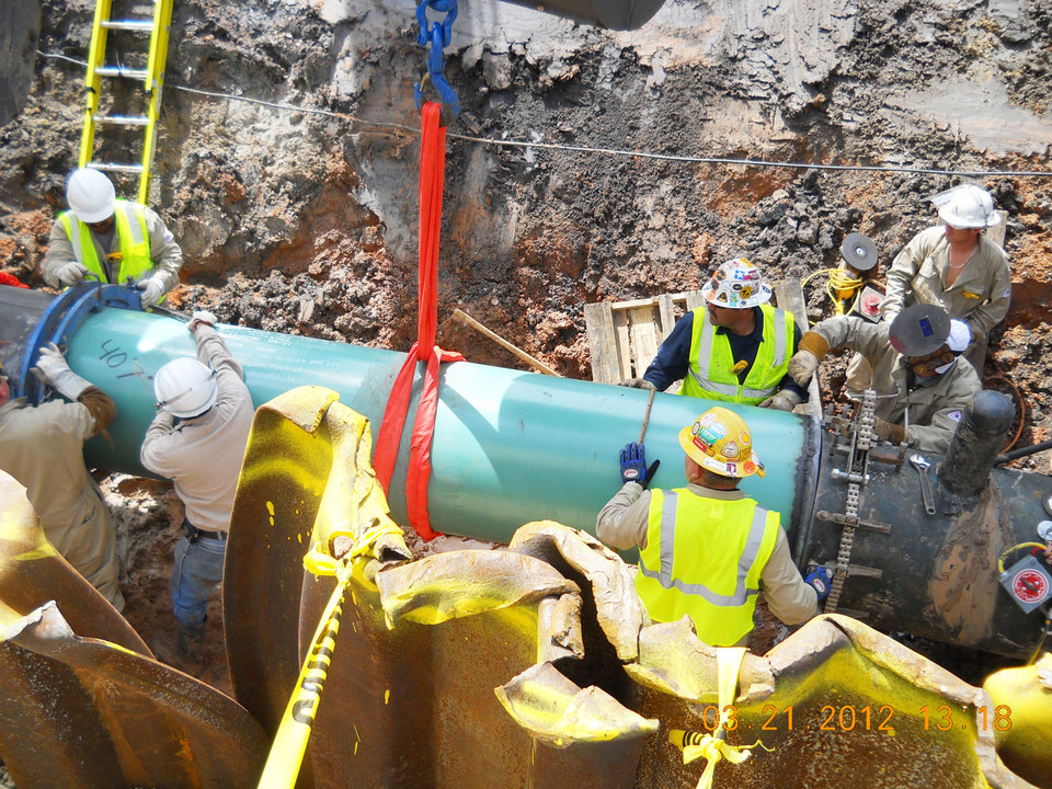 Photo - Field crews install a new piece of pipe for the Seaway pipeline at a valve site in Fort Bend County west of Houston. Photos provided by Enterprise Products Partners LP