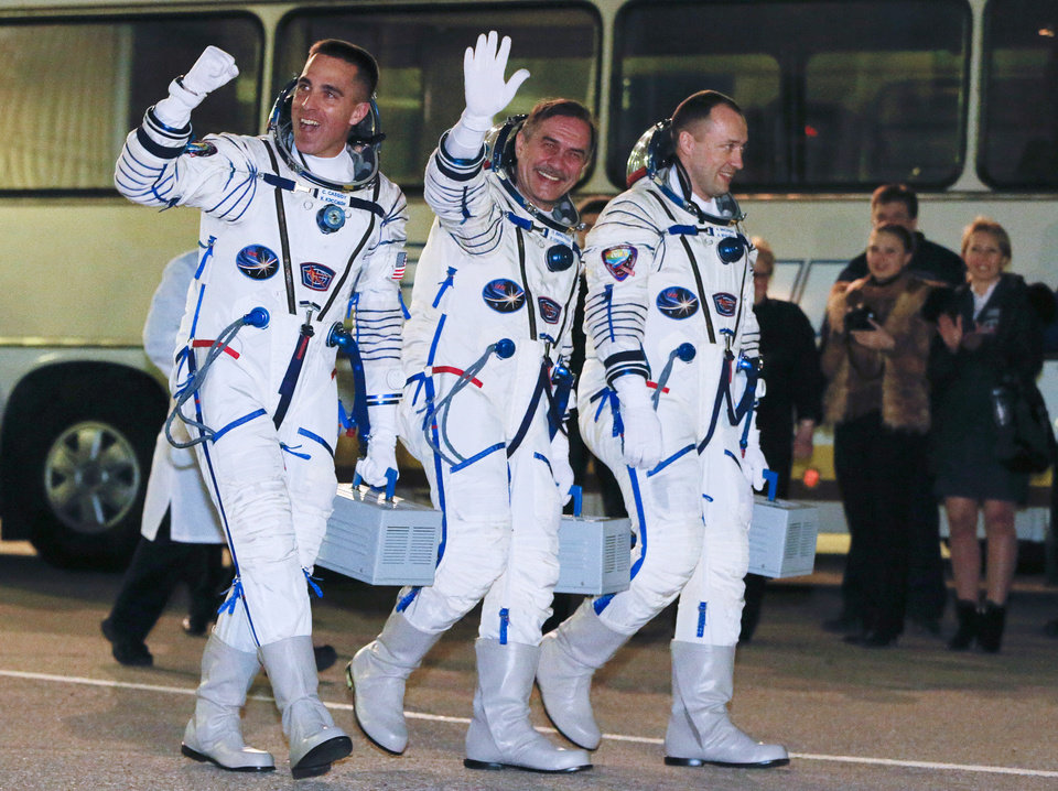 Photo - Russian Cosmonauts Alexander Misurkin, right, Pavel Vinogradov, center, and U.S. astronaut Christopher Cassidy, crew members of the mission to the International Space Station, ISS, walk prior the launch of Soyuz-FG  rocket at the Russian leased Baikonur Cosmodrome, Kazakhstan, Thursday, March 28, 2013.  (AP Photo/Dmitry Lovetsky, Pool)
