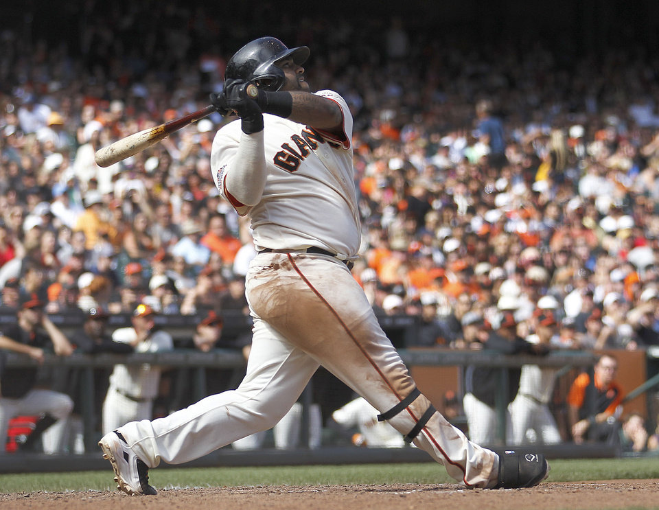 Photo - San Francisco Giants' Pablo Sandoval hit a triple to drive in 2 runs against the Pittsburgh Pirates in the eighth inning of a baseball game in San Francisco, Sunday, Aug. 25, 2013. Giants won 4-0. (AP Photo/Tony Avelar)