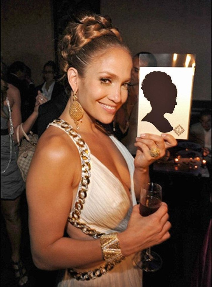 Photo - Actress and singer Jennifer Lopez holds a scissor-cut silhouette of herself, created by artist Karl Johnson. Johnson will be at Full Circle Bookstore from noon to 6 p.m. Sept. 20. Photo provided.