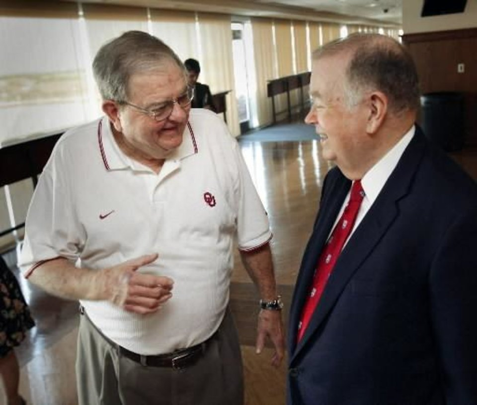 University of Oklahoma president David Boren, right, speaks with retiring radio announcer  Bob  Barry today. Photo by Steve Sisney
