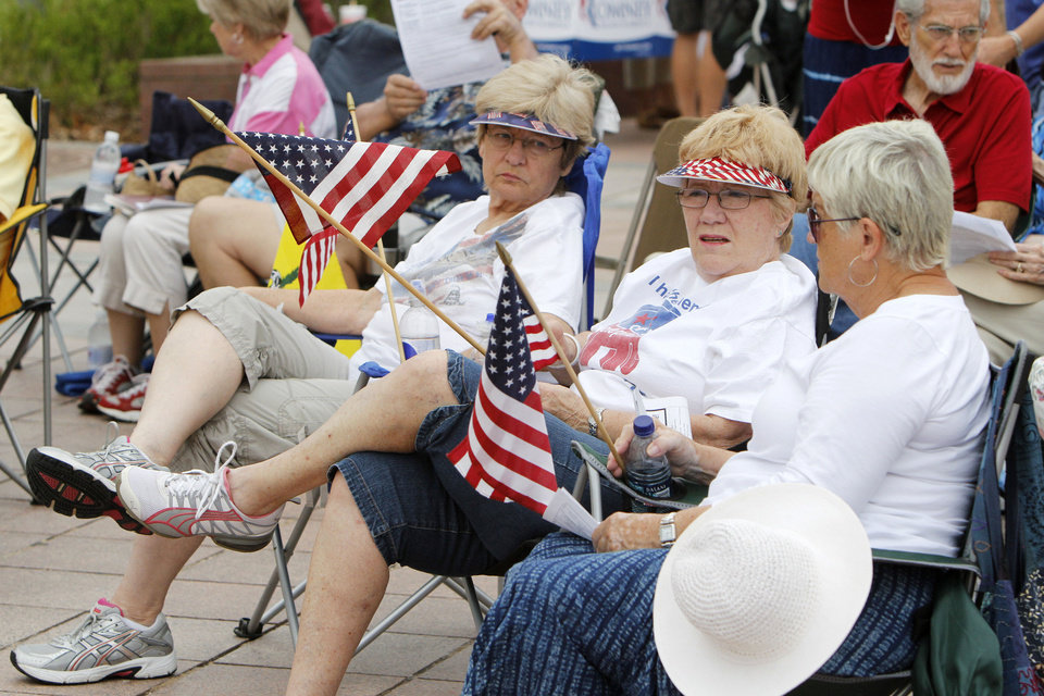 Photo - Loretta Hager (left), Pat Wathen, and Ruth Stephens listen to speakers during a healthcare rally on the south steps of the State Capitol building in Oklahoma City, OK, Saturday, July 7, 2012,  By Paul Hellstern, The Oklahoman
