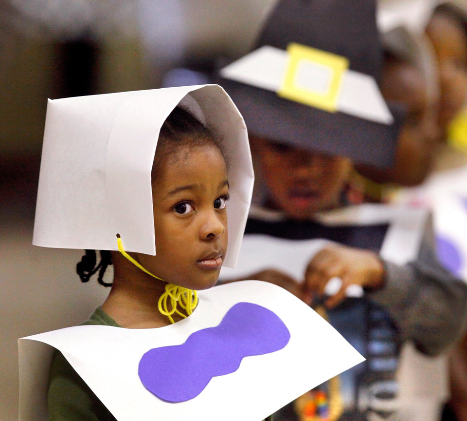 Photo - Students dressed as Pilgrims wait in line to get their food. ,Pre-kindergarten students partnered with fourth grade