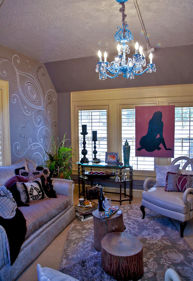 A master sun porch at the 2012 Symphony Show House includes transitional decor.