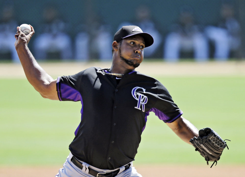 Photo - Colorado Rockies starting pitcher Juan Nicasio delivers against the Chicago White Sox in the first inning of a spring exhibition baseball game Tuesday, March 25, 2014, in Glendale, Ariz. (AP Photo/Mark Duncan)