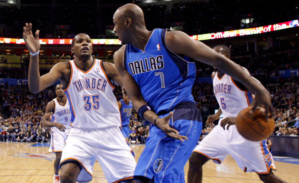 Dallas' Lamar Odom (7) passes the ball around Oklahoma City's' Kevin Durant (35) during a preseason NBA game between the Oklahoma City Thunder and the Dallas Mavericks at Chesapeake Energy Arena in Oklahoma City, Tuesday, Dec. 20, 2011. Photo by Bryan Terry, The Oklahoman
