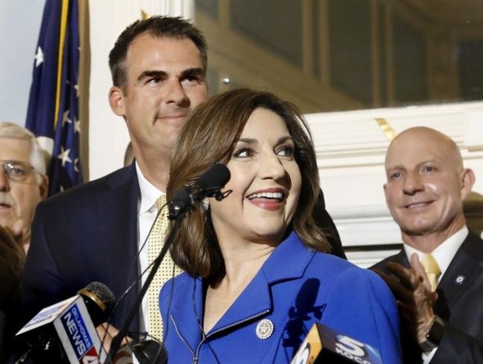 Photo -  Joy Hofmeister and Gov. Kevin Stitt, left, smile after the budget agreement was announced in May. Hofmeister is Oklahoma state schools superintendent. Gov. Stitt and leaders of the Oklahoma House and Senate announce at a news conference Wednesday, May 15, 2019, agreement for a state budget deal that includes more than $200 million in new education funding and pay raises for teachers and state employees. The $8.3 billion fiscal year 2020 budget is the largest in state history and includes about $500 million in new state spending.  [Jim Beckel/The Oklahoman]
