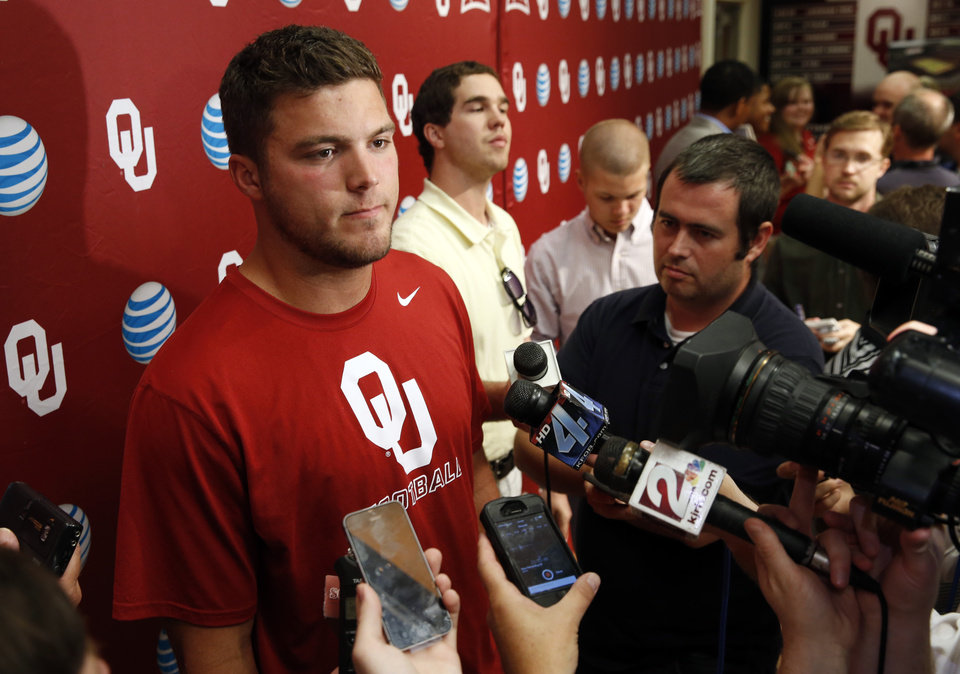 Photo - Tight end Blake Bell speaks with reporters during the University of Oklahoma (OU)  football team's media day in the Adrian Peterson Team Meeting Room on Saturday, Aug. 2, 2014 in Norman, Okla.  Photo by Steve Sisney, The Oklahoman