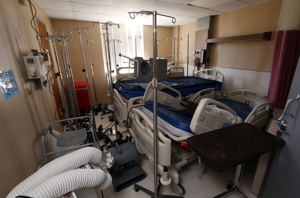 Photo -  The hospital is closed and dark in Frederick. Patient rooms are used for storage. [Photo by Steve Sisney The Oklahoman]