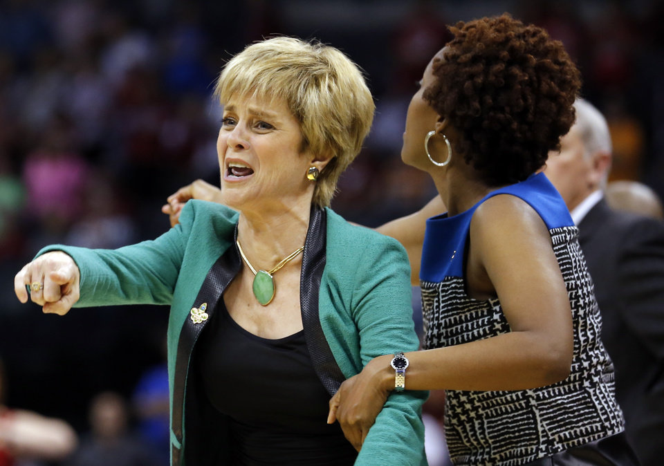 Baylor's head coach Kim Mulkey argues a call during college basketball game between Baylor University and the Louisville at the Oklahoma City Regional for the NCAA women's college basketball tournament at Chesapeake Energy Arena in Oklahoma City, Sunday, March 31, 2013. Photo by Sarah Phipps, The Oklahoman