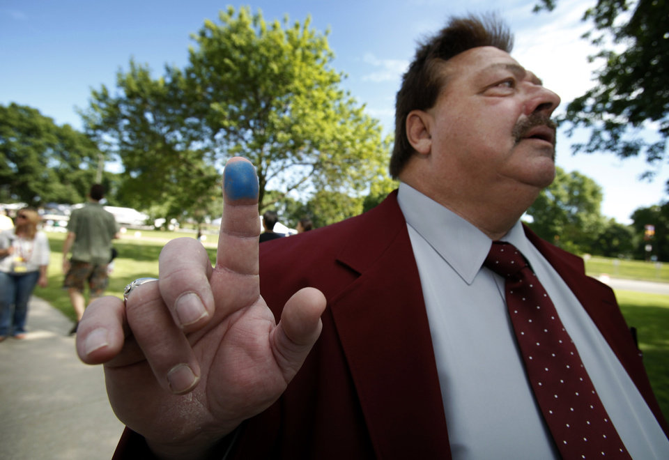 Photo -   Rodney Skinner, of Ottumwa, Iowa, shows his marked finger that indicates he voted after casting his ballot in the Republican Party's Iowa Straw Poll, Saturday, Aug. 13, 2011, in Ames, Iowa. (AP Photo/Charlie Neibergall)