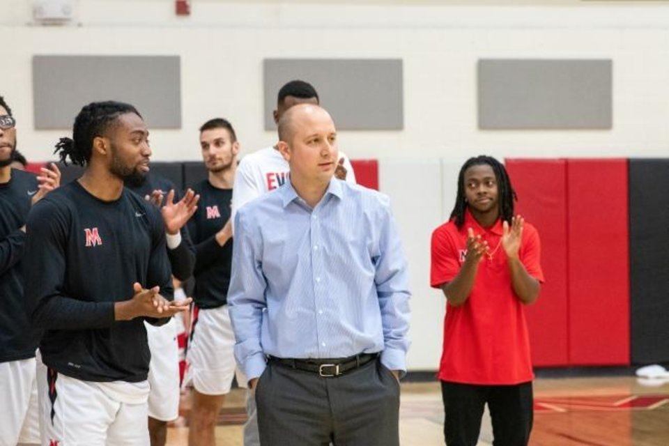 Photo -  Mid-America Christian men's basketball coach Josh Gamblin was honored earlier this season for his 100th career win. In his first four seasons as head coach, he's led the program to three NAIA Division-I tournaments and one national title. This year, his team is 25-1. [PHOTO PROVIDED]