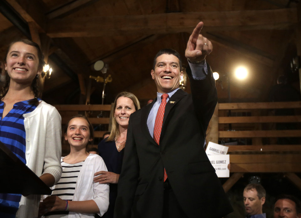 Republican candidate for the U.S. Senate Gabriel Gomez, right, points toward the audience as he takes the stage with his daughters Olivia, 13, left,  Antonia, 10, second from left, and wife Sarah, behind, before addressing an audience with a victory speech at a watch party in Cohasset, Mass., Tuesday, April 30, 2013. Gomez won his primary bid for the Republican nomination to contest a U.S. Senate seat, defeating Republican hopefuls Michael Sullivan and Dan Winslow. (AP Photo/Steven Senne)