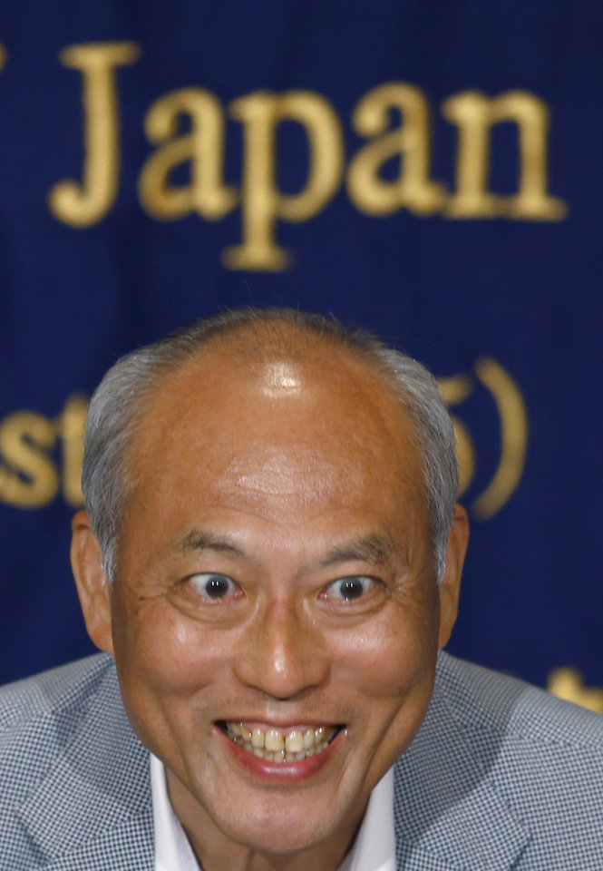 Photo - Tokyo Gov. Yoichi Masuzoe smiles during a press conference at the Foreign Correspondents' Club of Japan in Tokyo Wednesday, July 30, 2014. Masuzoe has defended his call for a review of the venue plan for the Tokyo 2020 Olympics, even if it threatens the proposal of having almost all the facilities close to the Athlete's Village. Tokyo won the right to host the 2020 Olympics with a promise to deliver a compact games with 28 of the proposed 33 competition venues within 5 miles (8 kilometers) of the village. (AP Photo/Shizuo Kambayashi)