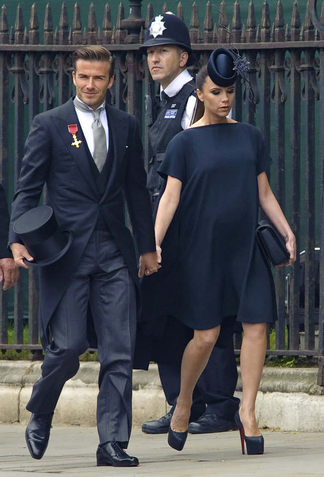 Photo - British soccer player David Beckham, left, and his wife, British fashion designer Victoria Beckham arrive at Westminster Abbey for the Royal Wedding in London, Friday, April, 29, 2011. (AP Photo/Fiona Hanson, Pool) ORG XMIT: RWFH106