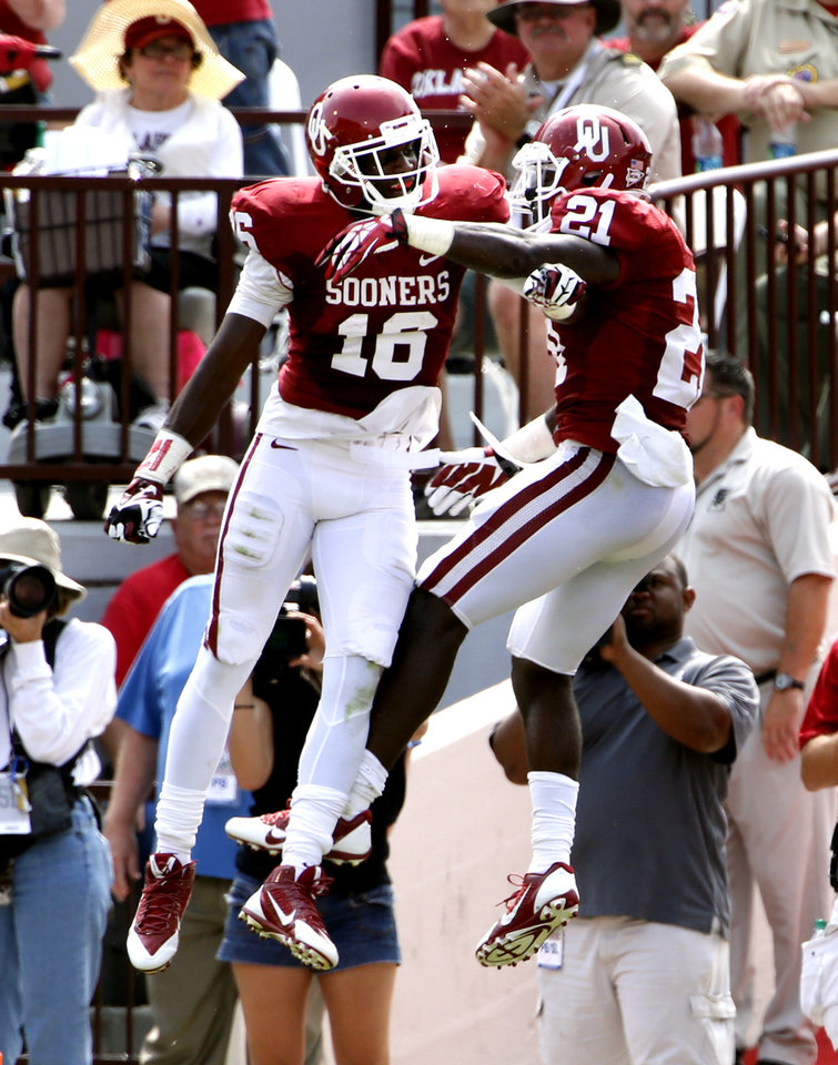Oklahoma's Keith Ford (21) celebrates a his touchdown reception with Jaz Reynolds (16) during the second half of a college football game between the University of Oklahoma Sooners (OU) and the Tulsa Golden Hurricane (TU) at Gaylord Family-Oklahoma Memorial Stadium in Norman, Okla., on Saturday, Sept. 14, 2013. Photo by Steve Sisney, The Oklahoman