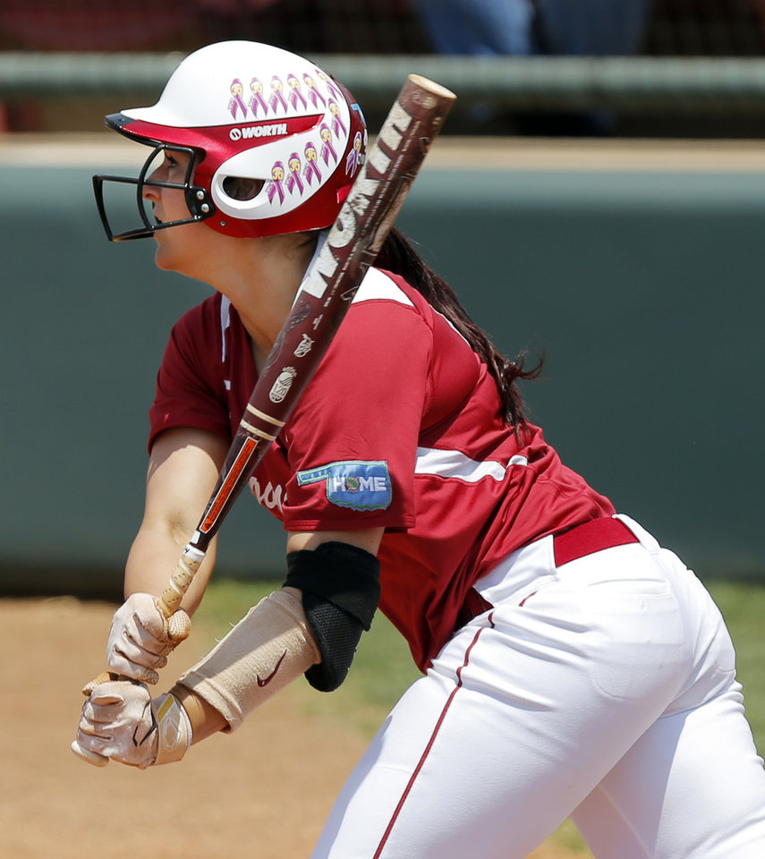 Photo - OU's Lauren Chamberlain (44) hits a 2-run home run in the fourth inning during the final game of the Norman Regional in 2014 NCAA softball championship between Oklahoma and Texas A&M in Norman, Okla., Sunday, May 18, 2014. OU won 11-6. Photo by Nate Billings, The Oklahoman