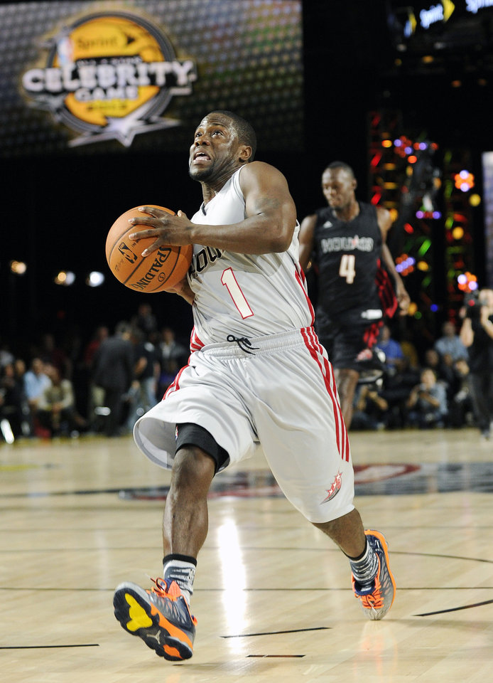 Comedian Kevin Hart (1) beats Olympic gold medalist Usain Bolt (4) to the basket in a race in the first quarter of the NBA All-Stars celebrity basketball game on Friday, Feb. 15, 2013, in Houston. (AP Photo/Pat Sullivan)