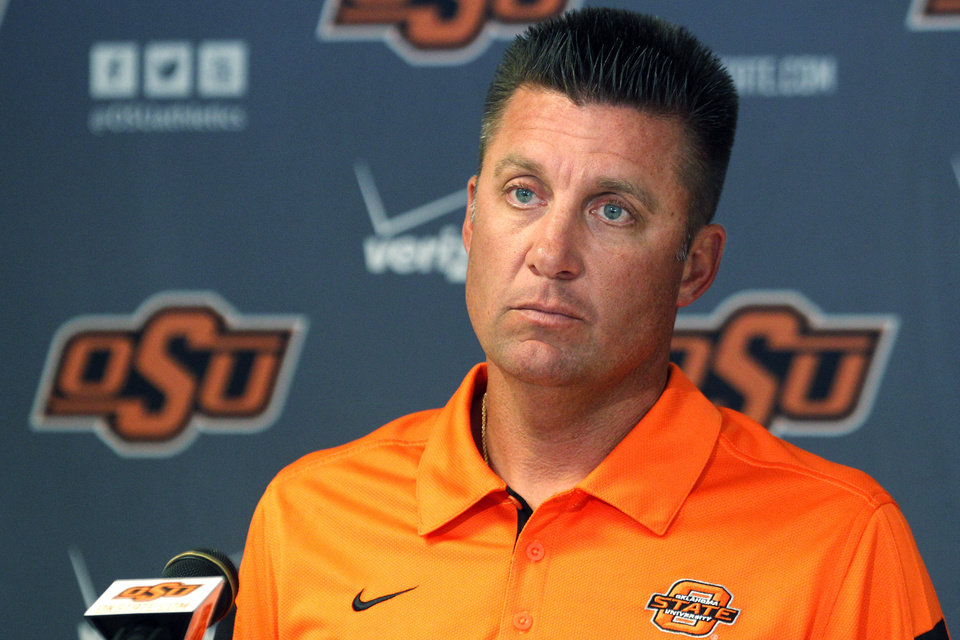 Photo -   Oklahoma State head coach Mike Gundy listens to a question during an NCAA college football news conference in Stillwater, Okla., Monday, Sept. 24, 2012. Gundy believes injured starting quarterback Wes Lunt could return to practice by the end of this week, although he's still uncertain whether he'll be able to play in Saturday night's game against Texas. (AP Photo/Sue Ogrocki)