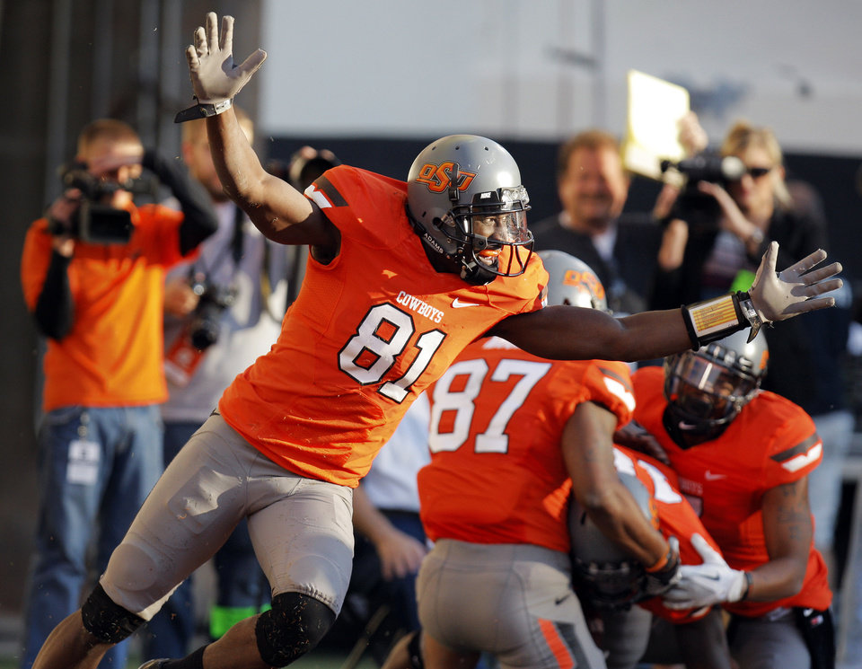 Photo - OSU's Justin Blackmon (81) reacts as the Cowboys celebrate a touchdown run by Herschel Sims (18) in the fourth quarter during a college football game between the Oklahoma State University Cowboys (OSU) and the Baylor University Bears (BU) at Boone Pickens Stadium in Stillwater, Okla., Saturday, Oct. 29, 2011. OSU won, 59-24. Photo by Nate Billings, The Oklahoman