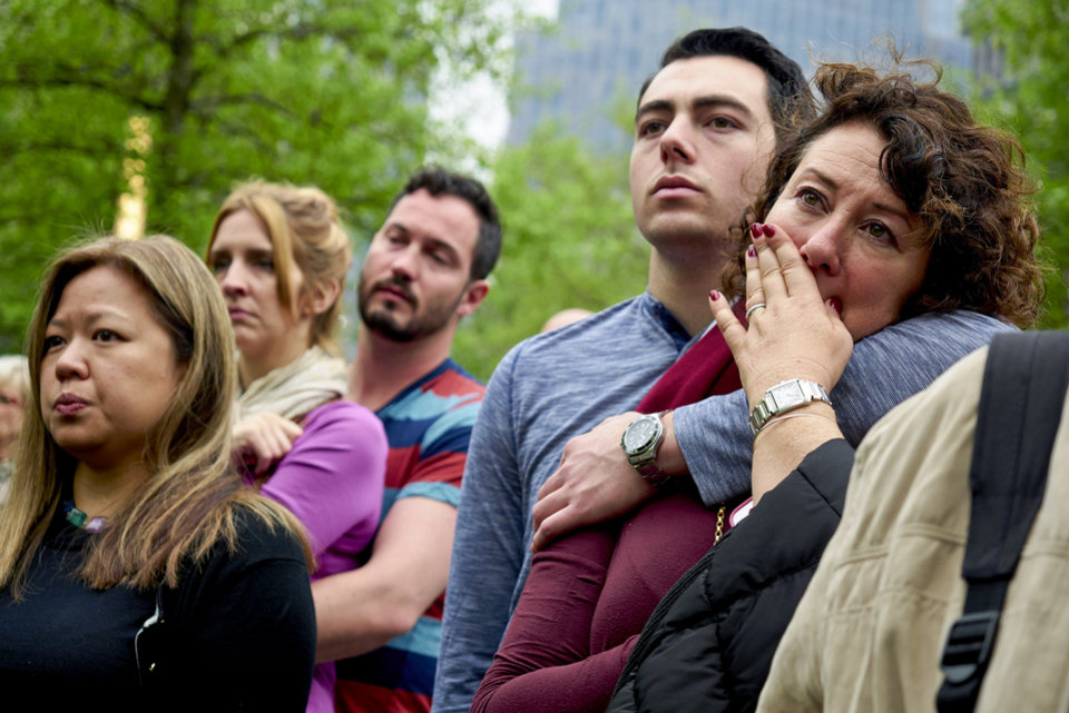 Photo - Visitors watch a screen projection of the dedication ceremony for the National September 11 Memorial Museum in New York, Thursday, May 15, 2014.  (AP Photo/New York Daily News, James Keivom, Pool)