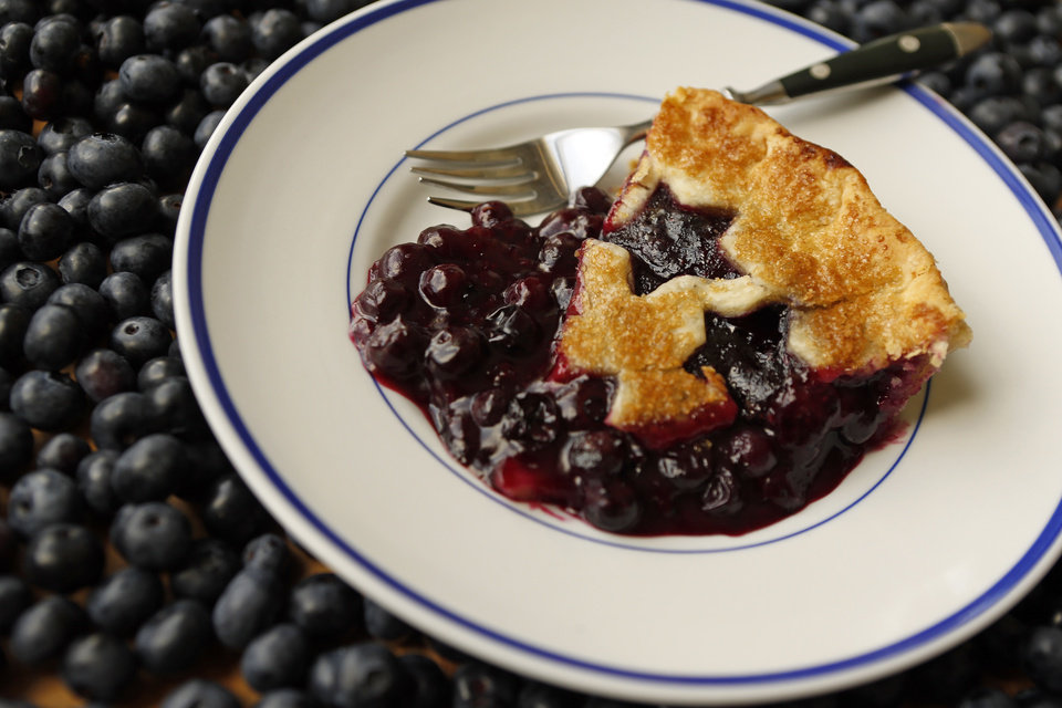 Photo -  A slice of blueberry pie was made with blueberries from Broken Arrow's Thunderbird Berry Farm. Photo by Nate Billings, The Oklahoman   NATE BILLINGS